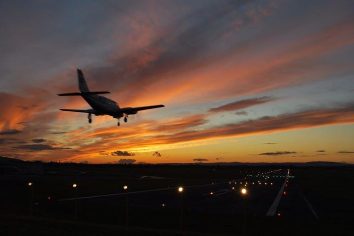 GLO plane landing sunset